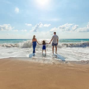 Family on the beach | Sustainability 101 – What, Why & How to Get Started