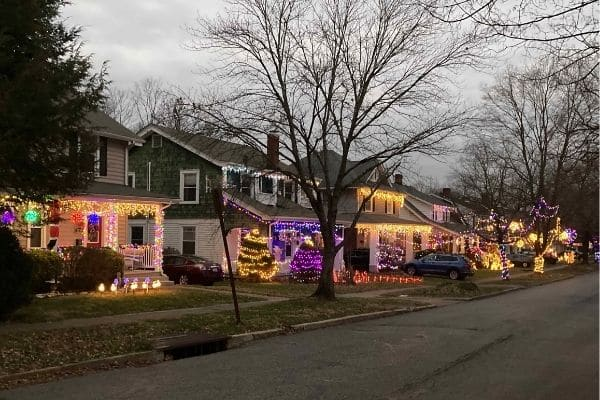 Outdoor Christmas lights on houses before dark