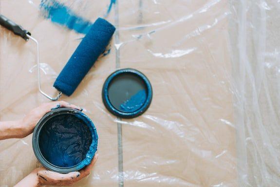 Blue Paint Beside Blue Paint Roller