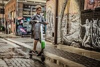 Boy on scooter | Scooters - Alternative Transportation - Conscious Consumer