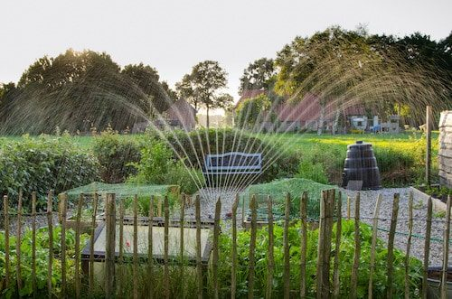 High arching sprinkler to avoid to conserve water outdoors