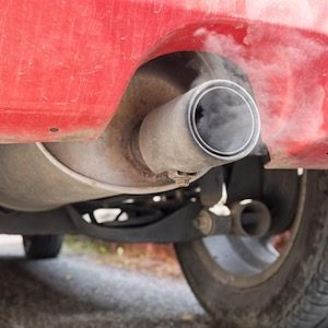 Red Car exhaust pipe pollution