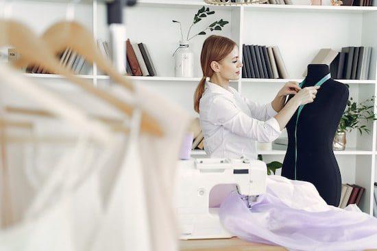 Woman in White Dress Shirt Holding White Printer Paper