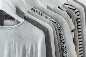 gray clothing on hanging rack