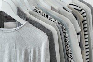 gray clothing on hanging rack