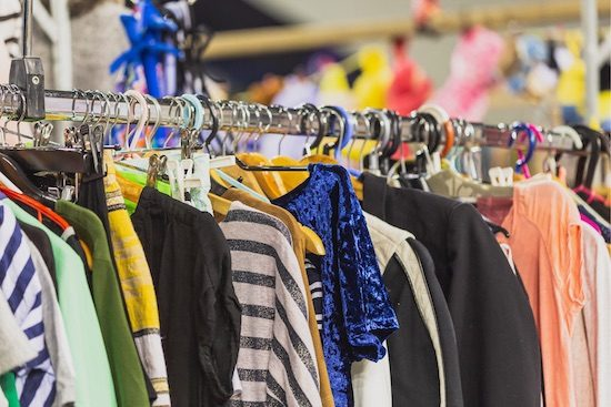 thrift shop clothing on rack is eco-friendly fashion
