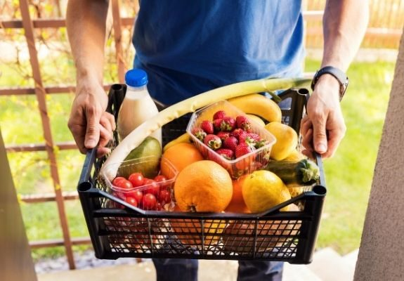 Food in crate by food deliverer