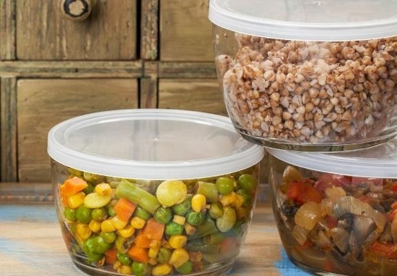 Leftover food in glass containers close up