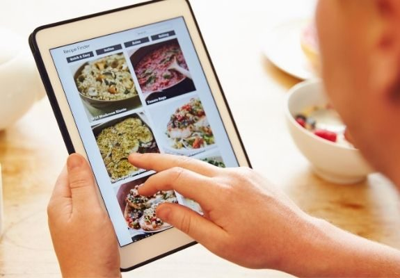 Person using recipe finder on tablet