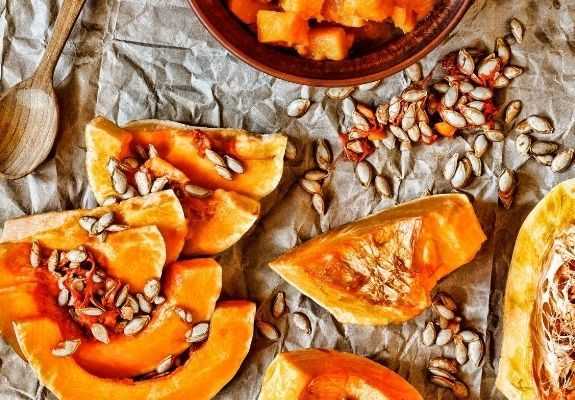 Pumpkins cut open and seeds