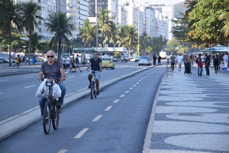 Bicyclists in Rio de Janeiro practicing eco-travel tip