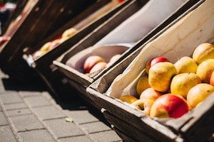 Yellow and Red Apples in Crate