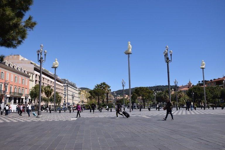 People walking across plaza in Nice France